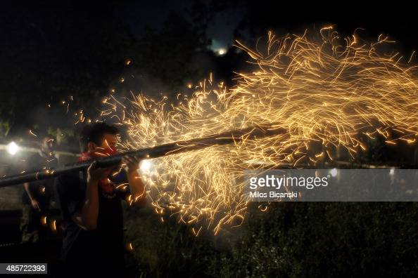 Revellers ignite rockets during Greek Orthodox Easter celebrations on the eastern Aegean island of Chios on April 19 2014 in Vrontados Greece As part...