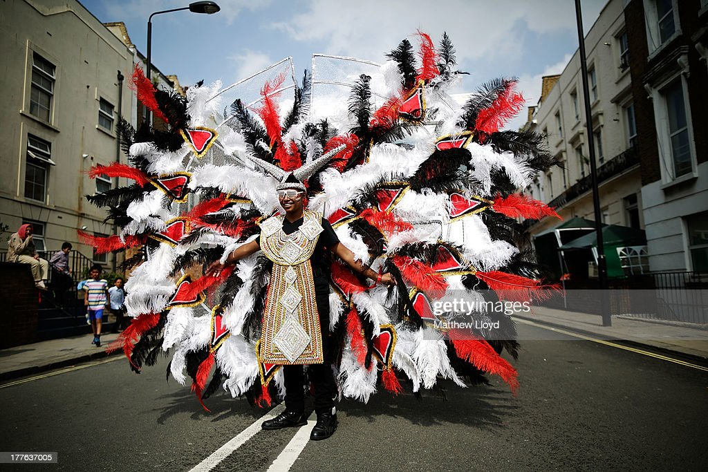 Revellers in costume take part in the Notting Hill Carnival on August 25, 2013 in London, England. More than one million people are expected to enjoy this year's Notting Hill Carnival. It is the largest street festival in Europe and was first held in 1964 by the Afro-Caribbean community. Over the bank holiday weekend the streets come alive to steel bands, colourful floats and costumed performers as members of the public flood into the area to join in the celebrations