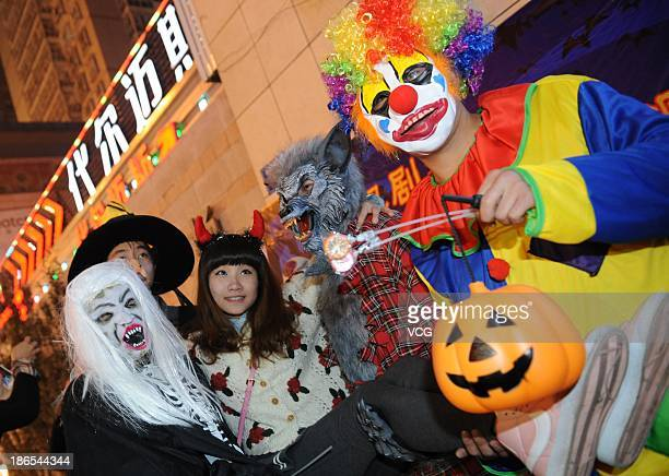 Revellers in fancy dress costumes celebrate Halloween on October 31 2013 in Taiyuan China