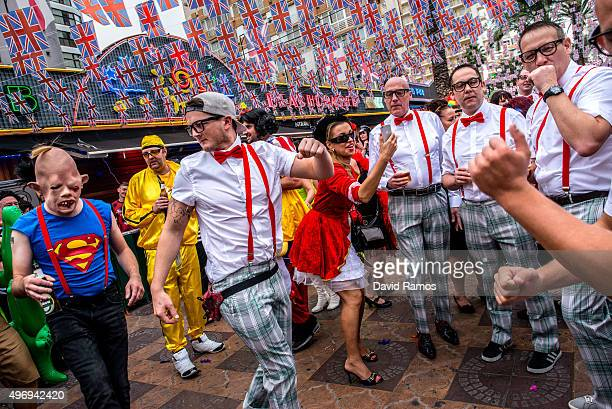 Revellers in fancy dress enjoy the atmosphere during the British Fancy Dress Day on November 12 2015 in Benidorm SpainThe British Fancy Dress Day is...