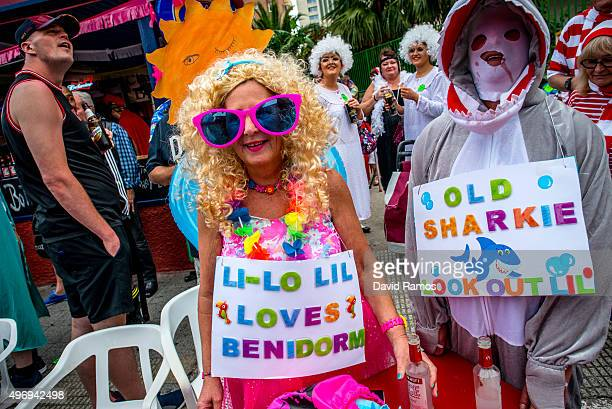Revellers in fancy dress enjoy the atmosphere during the British Fancy Dress Day on November 12 2015 in Benidorm Spain The British Fancy Dress Day is...