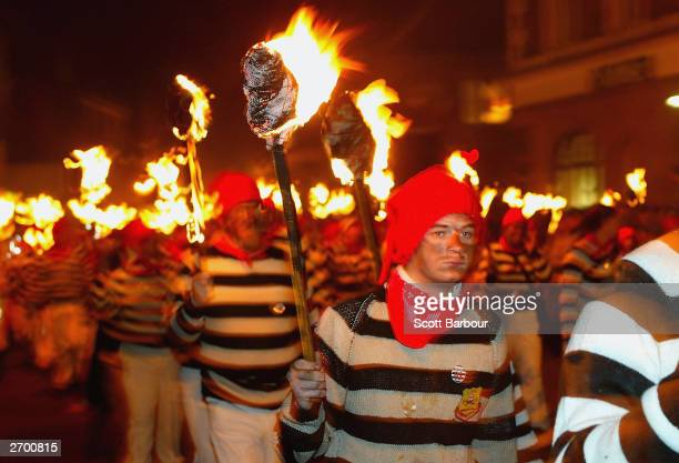 Revellers in fancy dress parade down the street during Bonfire Night celebrations November 5 2003 in Lewes England The celebrtions were held to...