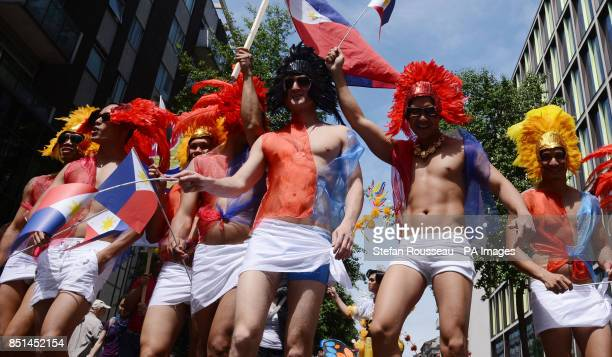 Revellers in fancy dress take part in the London Pride Parade 2013 in central London