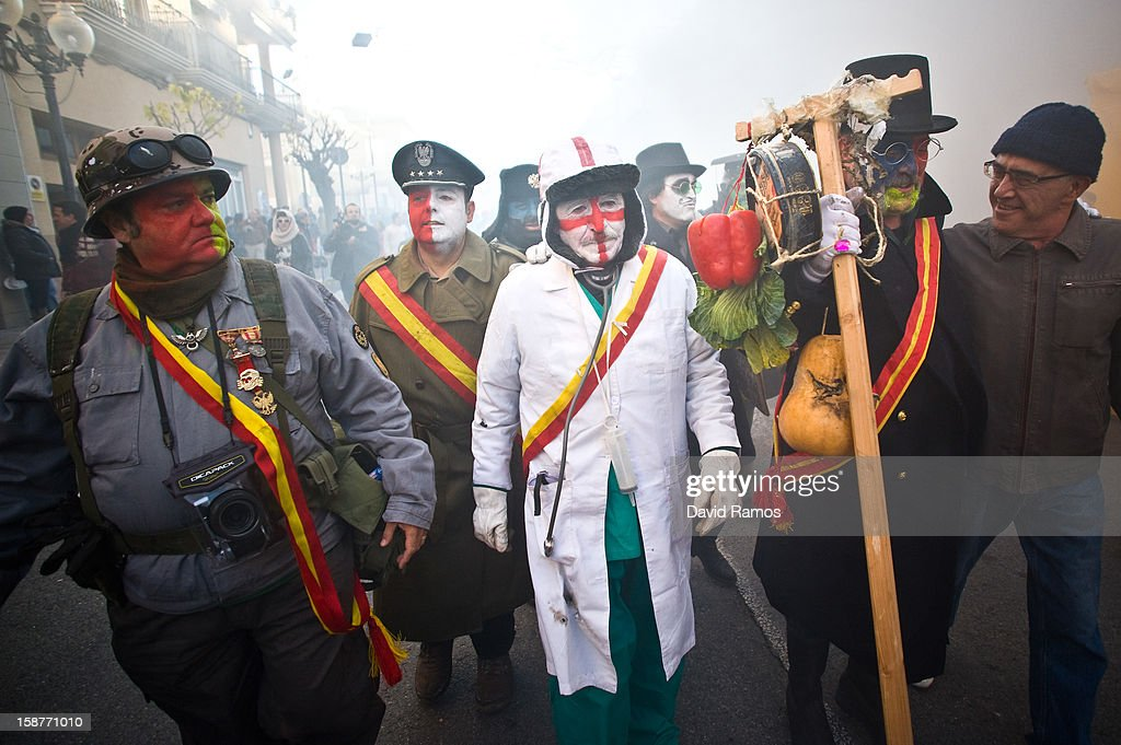 Revellers in fancy dress walk toward the battle of 'Enfarinats', a flour fight in celebration of the Els Enfarinats festival on December 28, 2012 in Ibi, Spain. Citizens of Ibi annually celebrate the festival with a battle using flour, eggs and firecrackers. The battle takes place between two groups, a group of married men called 'Els Enfarinats' which take the control of the village for one day pronouncing a whole of ridiculous laws and fining the citizens that infringe them and a group called 'La Oposicio' which try to restore order. At the end of the day the money collected from the fines is donated to charitable causes in the village. The festival has been celebrated since 1981 after the town of Ibi recovered the tradition but the origins remain unknown.