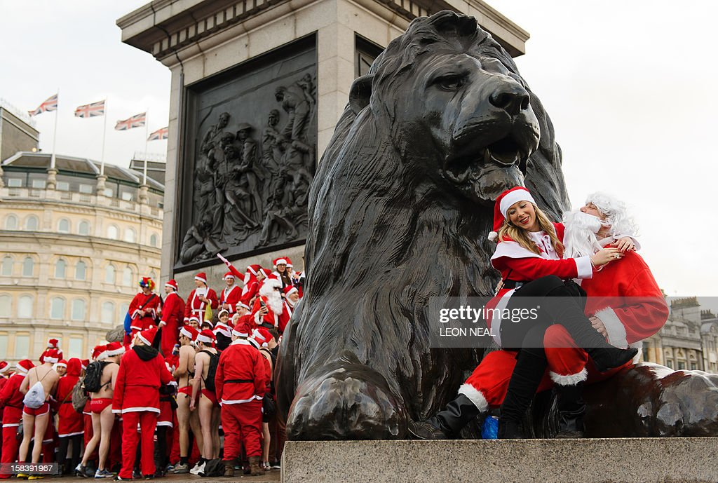 Revellers in Santa costumes gather around Nelson's Column during a 'Santacon' in Trafalgar Square in central London on December 15, 2012, less than two weeks before Christmas.
