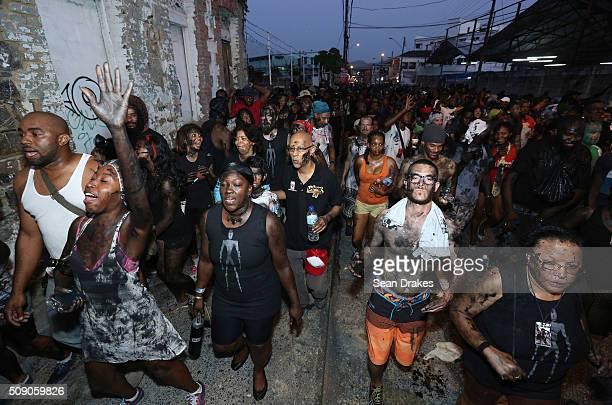 Revellers in the 3canal Jouvay band 'Blk Jab Nation' parade during j'ouvert as part of Trinidad and Tobago Carnival on February 08 2016 in Port of...