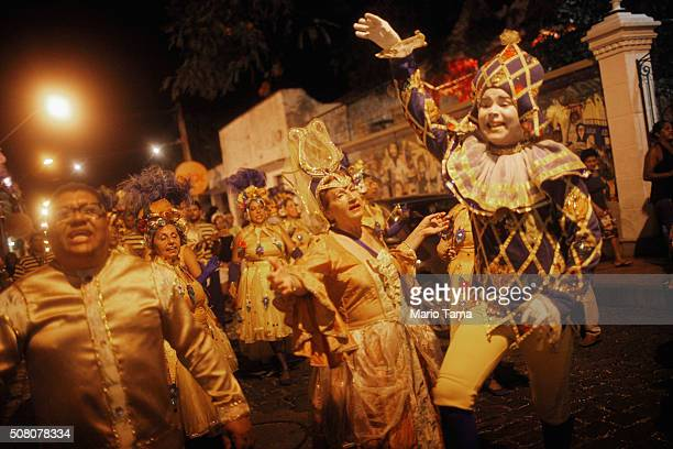 Revellers march during preCarnival celebrations on February 2 2016 in Olinda Pernambuco state Brazil In the last four months authorities have...