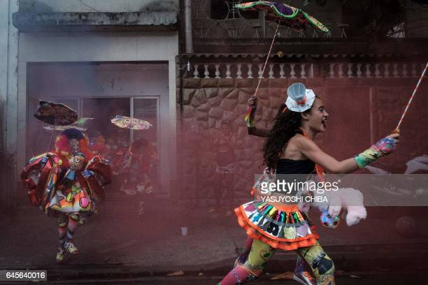 Revellers of batebola street carnival band perform on the first day of carnival in Rio de Janeiro Brazil on February 26 2017 The batebola traditional...
