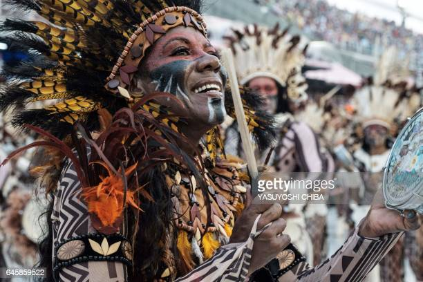 Revellers of BeijaFlor perform during the first night of Rio's Carnival at the Sambadrome in Rio de Janeiro Brazil early on February 27 2017 / AFP /...