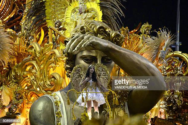 Revellers of BeijaFlor samba school perform during the first night of the carnival parade at Sambadrome in Rio de Janeiro Brazil on February 8 2016...