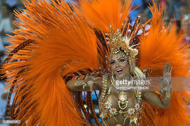 TOPSHOT Revellers of Estacio de Sa samba school perform during the first night of the carnival parade at the Sambadrome in Rio de Janeiro on february...