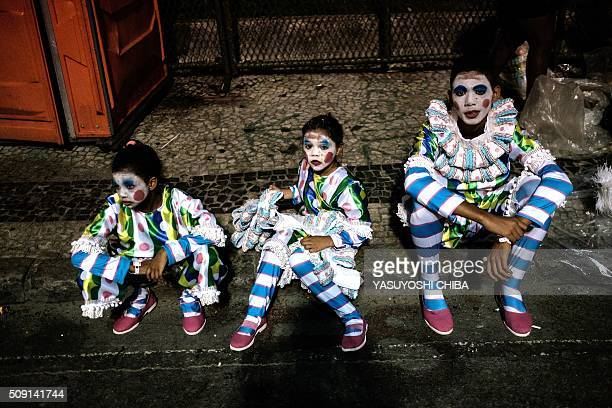 Revellers of Mangueira samba school wait to take part in the second night of the carnival parade at Sambadrome in Rio de Janeiro Brazil on February 9...