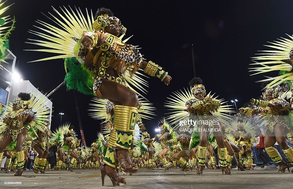 Revelers of Mocidade de Padre Miguel samba school perform during the first night of the carnival parade at Sambadrome in Rio de Janeiro, Brazil on February 8, 2016. AFP PHOTO/ VANDERLEI ALMEIDA / AFP / VANDERLEI ALMEIDA