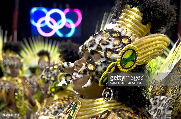 Revellers of Mocidade de Padre Miguel samba school perform during the first night of the carnival parade at Sambadrome in Rio de Janeiro Brazil on...