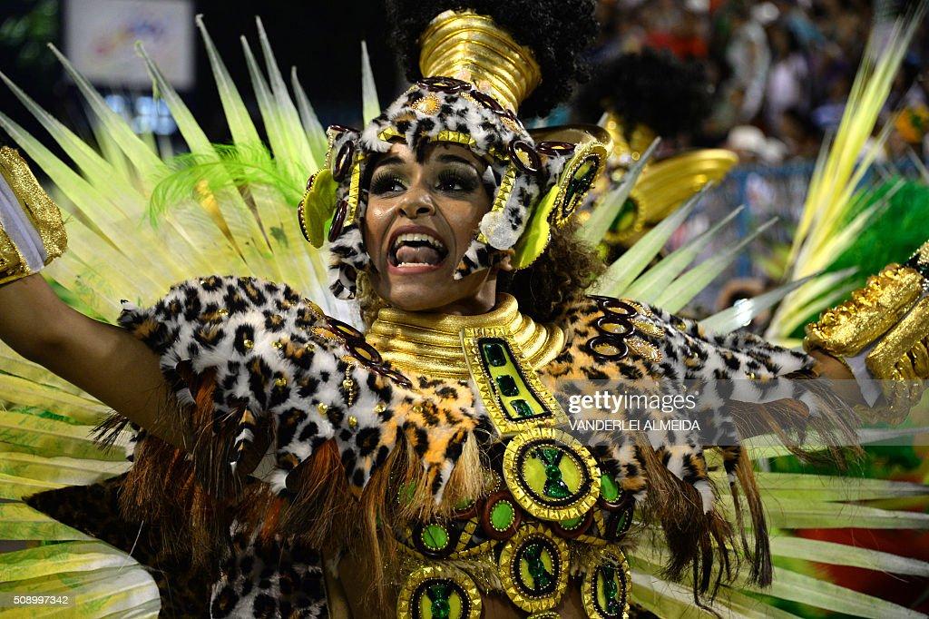 Revellers of Mocidade de Padre Miguel samba school perform during the first night of the carnival parade at Sambadrome in Rio de Janeiro, Brazil on February 8, 2016. AFP PHOTO/ VANDERLEI ALMEIDA / AFP / VANDERLEI ALMEIDA
