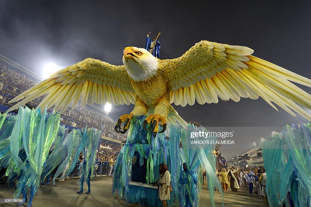 Revellers of Portela samba school perform during the second night of the carnival parade at Sambadrome in Rio de Janeiro, Brazil, on February 9, 2016. AFP PHOTO/ VANDERLEI ALMEIDA / AFP / VANDERLEI ALMEIDA