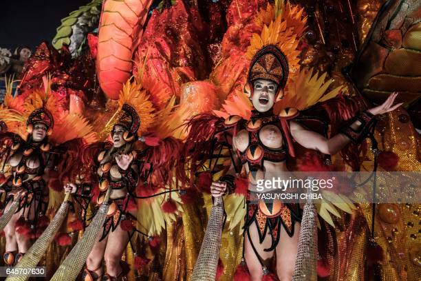 Revellers of the Grande Rio samba school perform during the first night of Rio's Carnival at the Sambadrome in Rio de Janeiro Brazil early on...
