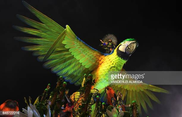 TOPSHOT Revellers of the Imperatriz Leopoldinense samba school perform during the first night of Rio's Carnival at the Sambadrome in Rio de Janeiro...