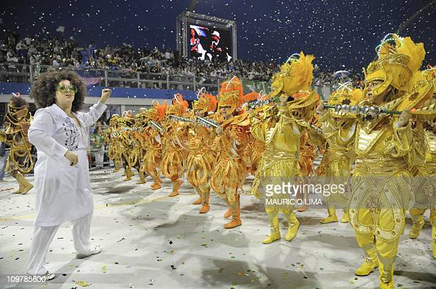 Revellers of the Mancha Verde samba school play instruments during the opening night of parades at the Sambadrome as part of Carnival celebrations in...