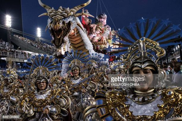 TOPSHOT Revellers of the Mangueira samba school perform on the second night of Rio's Carnival at the Sambadrome in Rio de Janeiro Brazil early on...