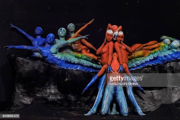 Revellers of the Paraiso do Tuiuti samba school perform during the first night of Rio's Carnival at the Sambadrome in Rio de Janeiro Brazil on...