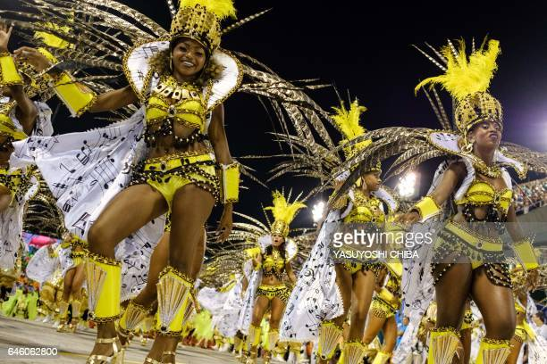 Revellers of the Sao Clemente samba school perform during the second night of Rio's Carnival at the Sambadrome in Rio de Janeiro Brazil on February...