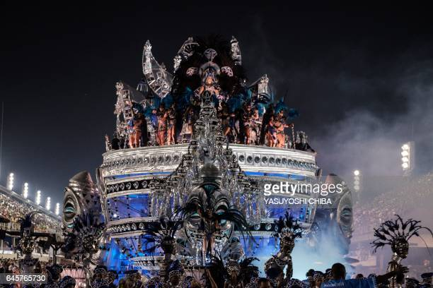 Revellers of the Unidos de Vila Isabel samba school perform during the first night of Rio's Carnival at the Sambadrome in Rio de Janeiro Brazil early...