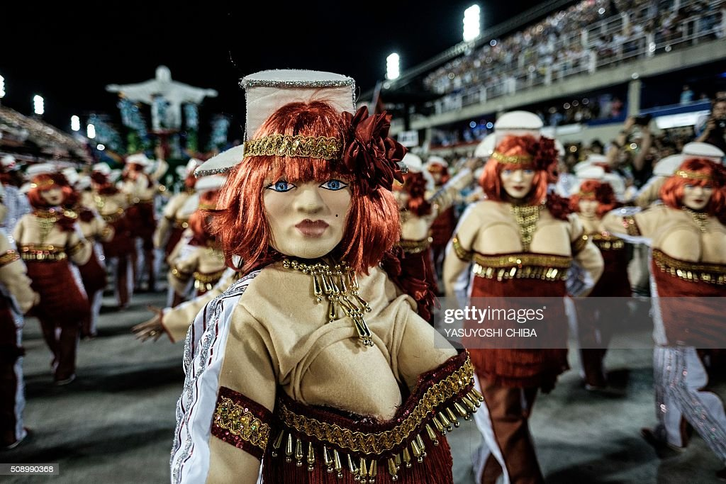 Revelers of Uniao da Ilha samba school perform during the first night of the carnival parade at Sambadrome in Rio de Janeiro, Brazil on February 7, 2016. AFP PHOTO / YASUYOSHI CHIBA / AFP / YASUYOSHI CHIBA