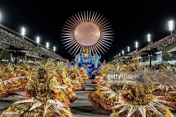 TOPSHOT Revellers of Uniao da Ilha samba school perform during the first night of the carnival parade at Sambadrome in Rio de Janeiro Brazil on...