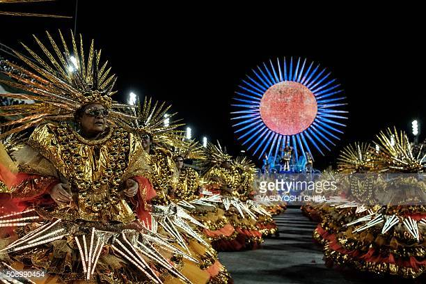 Revellers of Uniao da Ilha samba school perform during the first night of the carnival parade at Sambadrome in Rio de Janeiro Brazil on February 7...