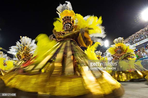 Revellers of Vila Isabel samba school perform during the second night of the carnival parade at the Sambadrome in Rio de Janeiro on february 08...