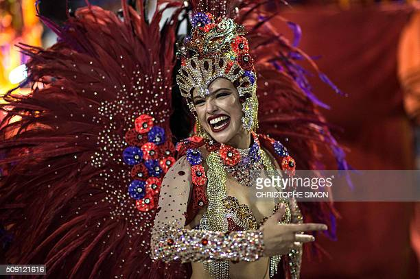 TOPSHOT Revellers of Vila Isabel samba school perform during the second night of the carnival parade at the Sambadrome in Rio de Janeiro on february...