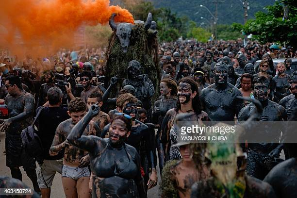 Revellers parade during 'Bloco da Lama' a mud carnival in Paraty about 250km south of Rio de Janeiro Brazil on February 14 2015 'Bloco da Lama' was...