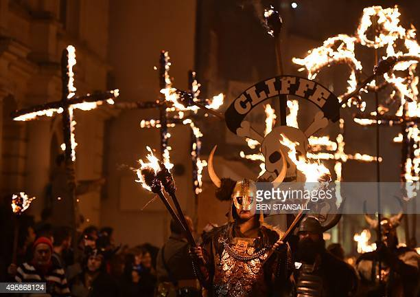 Revellers parade through the streets of Lewes in Sussex southern England on November 5 during the traditional Bonfire Night celebrations Bonfire...