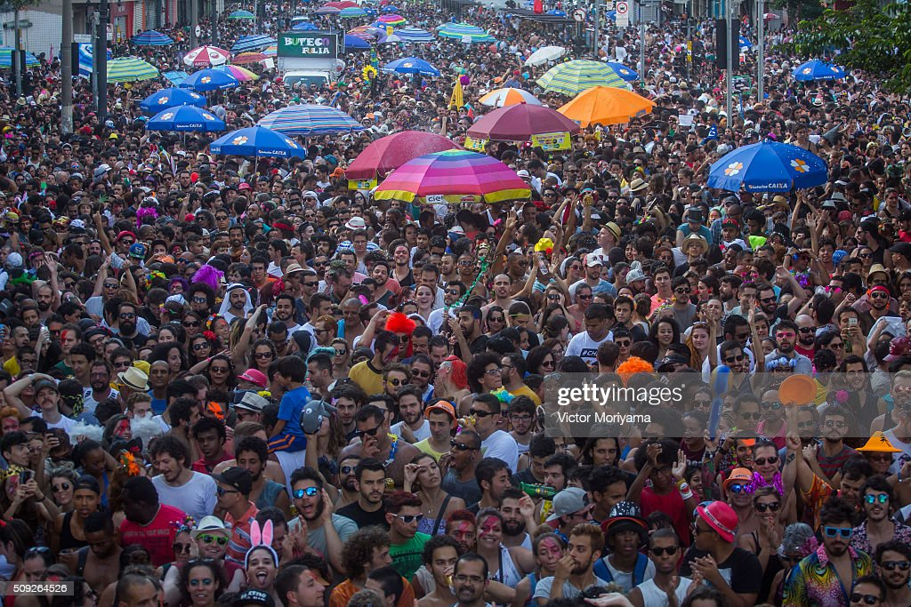 Revellers participate in the Carnival group parade honoring the singer David Bowie through the streets of downtown on February 9, 2016 in Sao Paulo, Brazil. The iconic musician died on January, 10, 2016 in New York City.