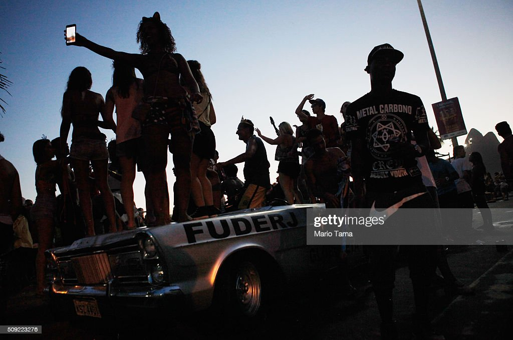 Revellers party atop a vehicle during Carnival celebrations at the Banda de Ipanema 'bloco', or street parade, on February 9, 2016 in Rio de Janeiro, Brazil. Festivities have continued throughout major Brazilian cities for Carnival in spite of the threat of the Zika virus. Today is the last official day of Carnival.