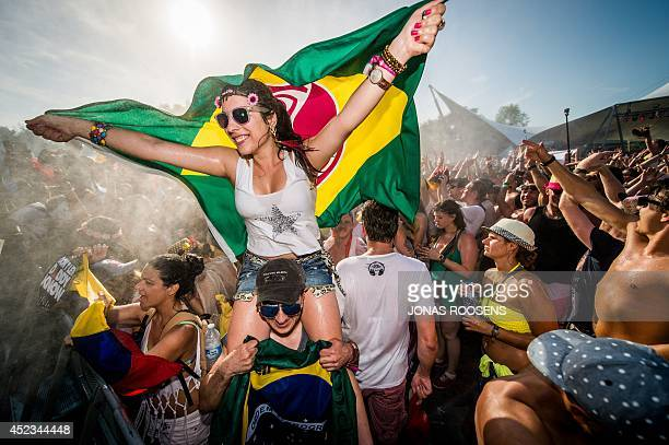 Revellers party during the first day of the Tomorrowland music festival in Boom on July 18 2014 The 10th edition of Tomorrowland electronic music...