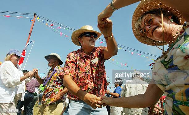Revellers perform cajun dancing on the first day of the New Orleans Jazz Heritage Festival April 28 2006 in New Orleans Louisiana This is the first...