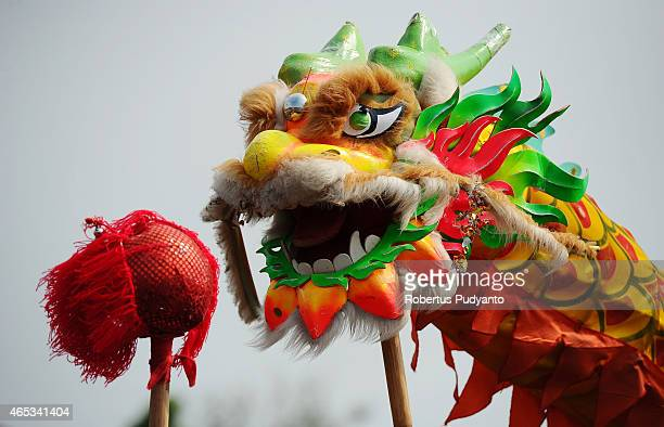 PONTIANAK KALIMANTAN INDONESIA MARCH 06 Revellers perform the 'Chinese Dragon' dance during Cap Gomeh Celebrations on March 6 2015 in Pontianak...