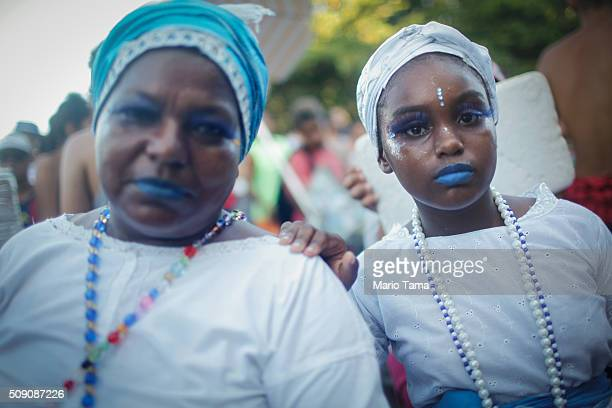 Revellers pose during Carnival celebrations at a bloco or street parade on February 8 2016 in Rio de Janeiro Brazil Festivities have continued...