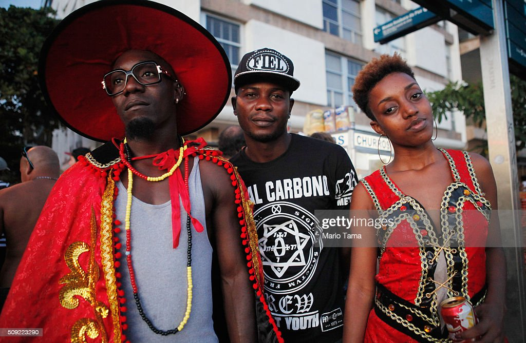 Revellers pose during Carnival celebrations at the Banda de Ipanema 'bloco', or street parade, on February 9, 2016 in Rio de Janeiro, Brazil. Festivities have continued throughout major Brazilian cities for Carnival in spite of the threat of the Zika virus. Today is the last official day of Carnival.