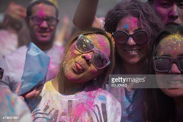 Revellers pose for a photo as they take part in Holi celebrations organised by members of South Korea's Indian community at Haeundae beach in the...