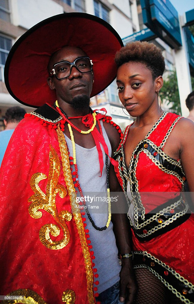 Revellers pose in dress from Angola, their native country, during Carnival celebrations at the Banda de Ipanema 'bloco', or street parade, on February 9, 2016 in Rio de Janeiro, Brazil. Festivities have continued throughout major Brazilian cities for Carnival in spite of the threat of the Zika virus. Today is the last official day of Carnival.