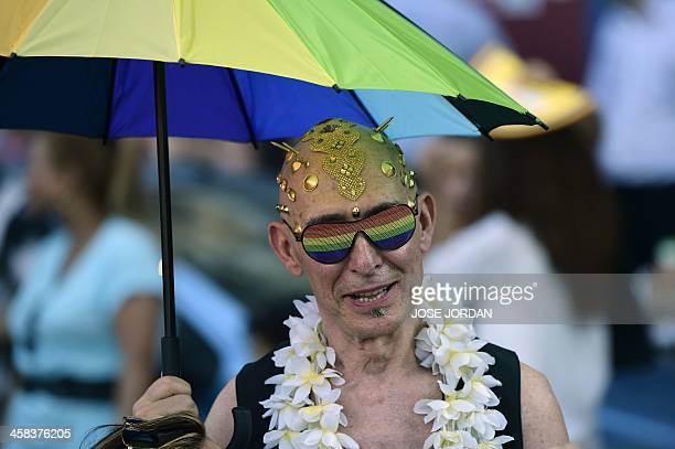 A revellers poses in fancy dress during the Gay Pride Parade in Madrid on July 2 2016 / AFP / JOSE JORDAN