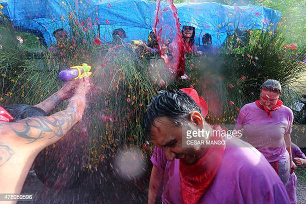 Revellers pour wine on each other during the'Batalla del Vino' in Haro on June 29 2015 Every year thousands of locals and tourists climb a mountain...