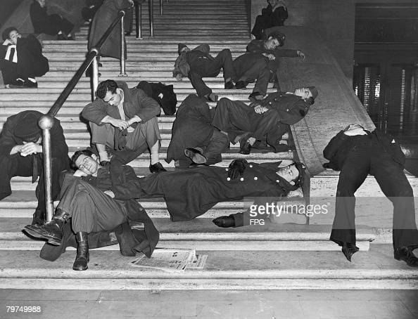 Revellers recovering from New Years Eve celebrations on the steps of Grand Central Station New York circa 1940