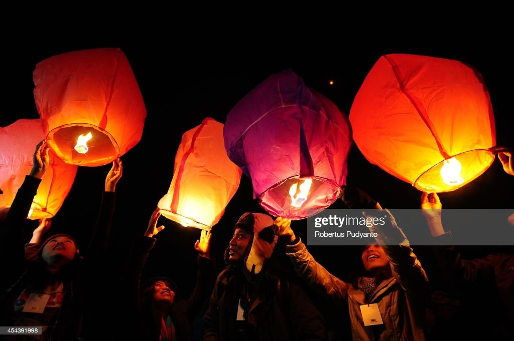 Revellers release sky lanterns during Dieng Cultural Festival 2014 on August 30, 2014 in Dieng, Java, Indonesia. The Dieng Culture Festival is an annual event presenting a variety of arts and culture culminating with a hair trimming ritual ceremony of dreadlocked children, known as the Ruwatan Rambut Gimbal.