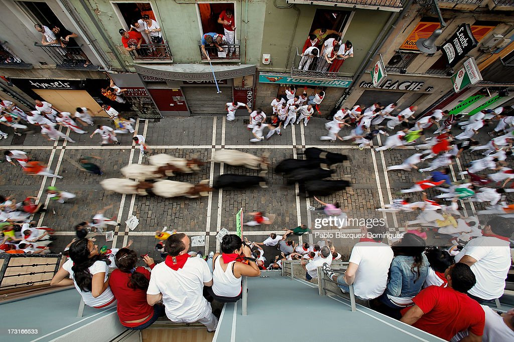 Revellers run with Valdefresno's ranch fighting bulls at Calle Estafeta during the fourth day of the San Fermin Running Of The Bulls festival, on July 9, 2013 in Pamplona, Spain. The annual Fiesta de San Fermin, made famous by the 1926 novel of US writer Ernest Hemmingway 'The Sun Also Rises', involves the running of the bulls through the historic heart of Pamplona, this year for nine days from July 6-14.