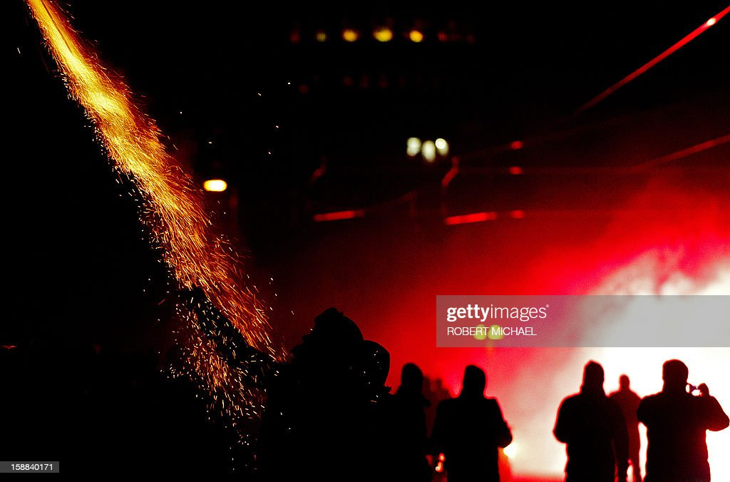 Revellers set off firecrackers in Dresden, eastern Germany on January 1, 2013 during the New Year's celebrations. MICHAEL