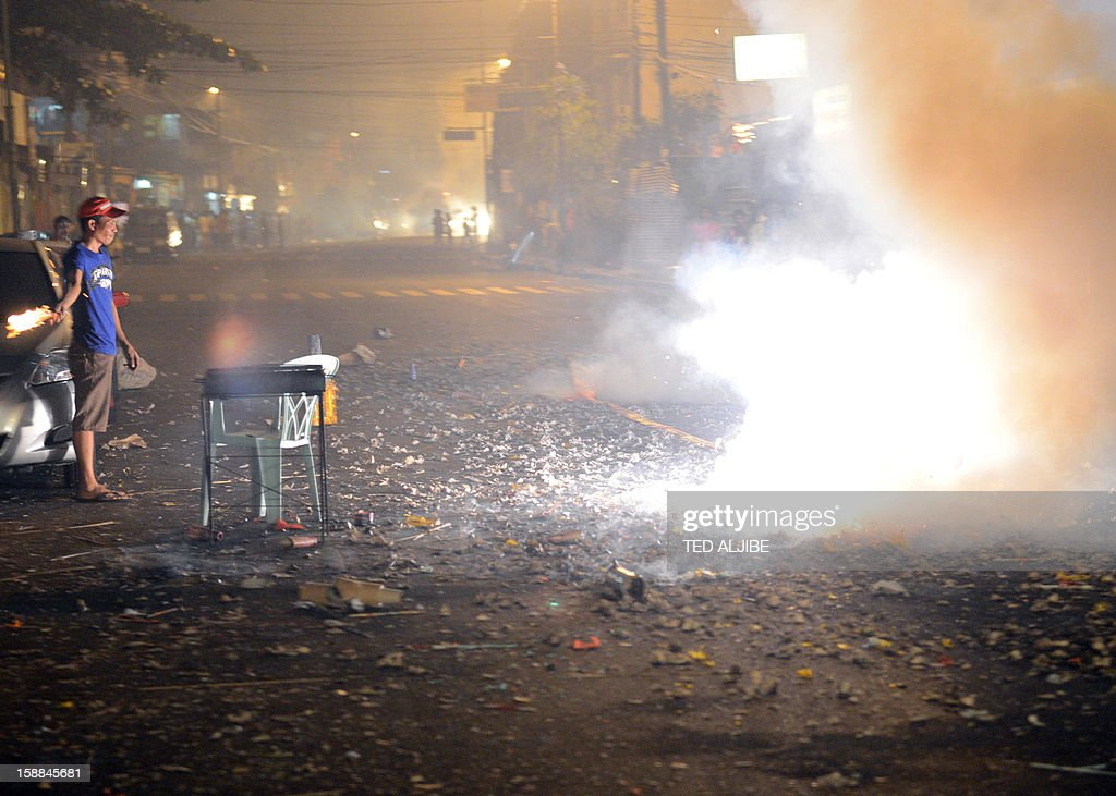 Revellers set off firecrackers to usher in New Year's Day in Manila early on January 1, 2013. In the capital Manila, authorities had been bracing for the annual rush of injuries as families celebrated with do-it-yourself firework displays and shot celebratory bullets into the air.
